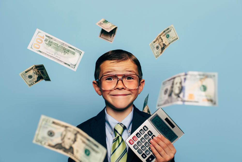 Child with Money and Calculator